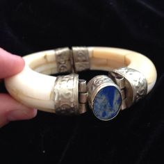 "VINTAGE one of a kind Indonesian ivory bracelet This is one of a kind bracelet made in Indonesia authentic ivory and authentic blue lapis stone  2.25"" inside bangle❤️❤️ this a beautiful piece vintage 1980 bought in Jakarta Original handmade Jewelry Bracelets"