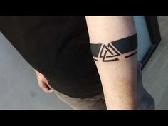 About this video: Latest Armband Tattoo made today. Armband tattoos are in trend. This is simple black band tattoo with double triangle and direction arrows . Black Band Tattoo, Tribal Band Tattoo, Wrist Band Tattoo, Forearm Band Tattoos, Tattoos Arm Mann, Black Tattoos, Bracelet Tattoo For Man, Aztec Tribal Tattoos, Tattoo Neck