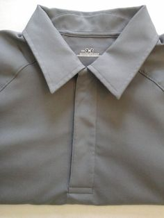 This listing is for a mens small under armour coaches style polo shirt. In excellent condition.