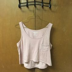 American Eagle tank top crop top! Light pink American eagle tank top crop top with a pocket! In perfect condition! American Eagle Outfitters Tops Crop Tops