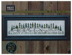Bent Creek Begin Row - Cross Stitch Pattern. A journey of a thousand miles must begin with a single step. Model stitched on 30 Ct. Confederate Gray linen with W