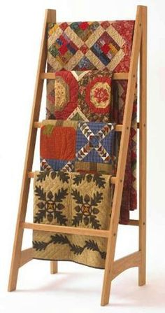 Simple design, basic power tools, and a few boards help you make this great quilt rack. You can hang as many as four quilts on the rungs of this graceful rack. The design of this ladder-style quilt r...