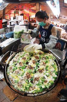 Oyster omelet at the Taiwan Night Market. https://ExploreTraveler.com