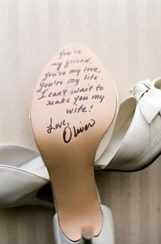 Bride & Groom write a sweet message on each other's shoe... love it!