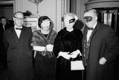 Historian and writer Arthur Schlesinger Jr., left, with his wife Marian join writer Walter Lippmann, at far right, and his wife Helen as they arrive at Truman Capote's Black and White Ball at New York City's Plaza Hotel at 59th Street and Fifth Avenue on Nov. 28, 1966. (AP)
