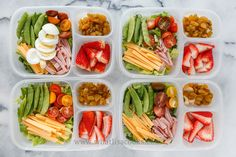 """""""Don't call it salad"""". My kids say they don't like salad, but they like all of this stuff! Lettuce, tomatoes, cheddar cheese, ham, and sugar snap peas. One has sliced boiled egg. On the side: strawberries, raisins, and cashews. Packed in  Easy Lunchboxes ."""