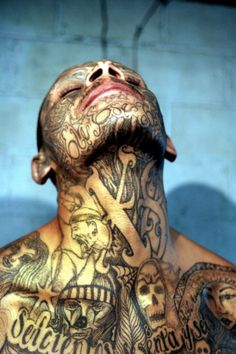 These are gang tattoos of inmates in South America prisons. The ornately tattooed Mara Salvatrucha and the Street gang members are many. Lowrider, Face Tattoos, Body Art Tattoos, Sleeve Tattoos, Tatoos, 13 Tattoos, Neck Tattoo For Guys, Tattoos For Guys, Couple Tattoos