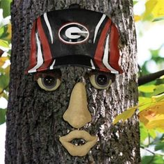 Georgia Bulldogs Forest Face by Team Sports America. $19.95. Made of 100% resin. Bring your trees to life with these offically licensed forest faces. The weather resistant resin face features a cap that is adorned with the official team logo. Original way to show your friends and neighbors how much you love your favorite team. Decorate your favorite tree with team spirit by showcasing this officially licensed team forest face. NCAA Georgia Bulldogs Forest Face