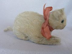Antique Steiff 'Crouching Cat' c1910s - by Abbingdon AuctionsEstimated Price: AUD200 - AUD300 Description: Rare sparse white mohair crouching Steiff Cat 1910 - 20s. Underscored ear button, green radiating glass eyes, 10cm tall X 18cm long. Wood fill and very hard to find.