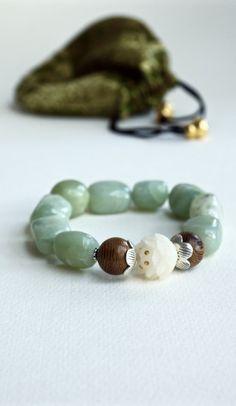 Pure white lotus yoga bracelet from Pillow Book Jewelry Yoga Bracelet, Jade Bracelet, Bohemian Bracelets, Beaded Bracelets, Jade Yoga, Yoga Mala, Lotus Yoga, Book Jewelry, White Lotus