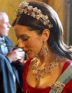 Princess Mary, wearing a befitting array of royal jewels, arrives for a Gala performance at Copenhagen's Royal Theatre.