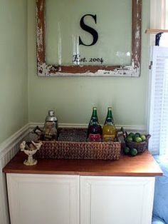 Cute use of frame...old frame from Mom's and use above the new wet bar
