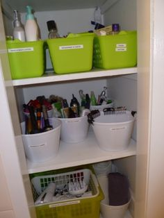 Bathroom cabinet organization with bins from the dollar store and a label maker. by Clausentt