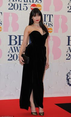 Model behaviour: Daisy Lowe looked beyond stunning in a black strapless gown after a week ...