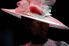 A model presents a creation from Nigerian Ade Bakare's collection, 12 August 2005, during the third day of the Nokia fashion week at Cape Town International Conference Center, part of the Pan African showcase. A number of African Fashion Designers participate in the events to show the new trend for the Spring/Summer collection 2006 til Saturday. (AFP/GIANLUIGI GUERCIA)