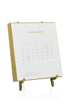 amp up your office space with 15 chic accessories a gold accented calendar adds elegance chic office ideas 15 chic