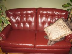 """This """"leather"""" sofa is actually a cloth covered sofa that has been painted! I can't WAIT to do this!!!"""