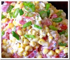 Creamy Ranch Corn Salad:  1 (16 oz) package frozen whole kernel corn, partially thawed OR 2 cans drained whole kernel corn   1-2 cloves garlic, minced    2-3 chopped green onions   1 medium tomato, seeded and diced   1/2 cup diced red or green pepper   1 cup bottled ranch dressing (more or less according to taste)  Gently combine all ingredients.  Cover and refrigerate until ready to serve.