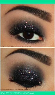 black eyeshadow, grey in the crease, creamy highlight on the brow and inner corner. Black on the waterline and lower lashline, and a sparkly black glitter on the lid