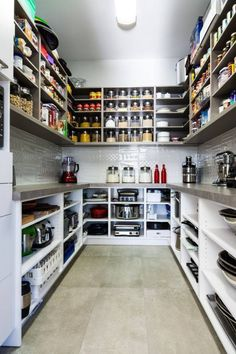 Love this set up - high shelves for dry ingredients, counter for unpacking/extra storage and large shelves for appliances underneath.