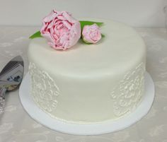 Peony bridal shower cake. Fondant covered cake with buttercream embroidery on the sides. Gumpaste peony on the top.