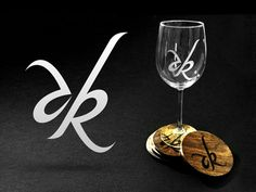 ak wedding monogram (Andrew+Kendra) and its application (sandblasted wine glasses, and wood burned coasters.) by Kenny Sing