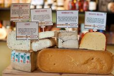 The 'Best Cheese Shop' is Cheesetique in Alexandria.  Three of their most popular local cheeses are Dragon's Breath, Grayson and Appalachian.