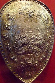 Shield of Henry II of France depicting Hannibal at the battle of Cannae Steel embossed and damascened with gold and silver French about 1555 CE