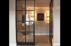 Glazen binnendeur in stalen frame