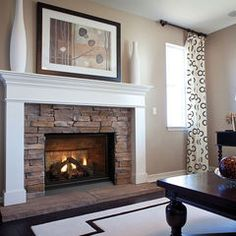 In our main living room on the lake level , the firebox inside lining is like this one. I like the simple lines and rustic stone but would have to add more white trim above mantel area and around sides of box in my living room.
