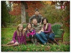 Family Portrait In A Field On A Red Couch Photo Shoot