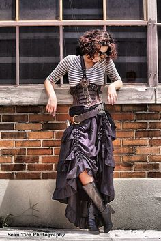 How to Recreate This Chic, Effortless Steampunk Style - Product and store recommendations and styling tips. Includes recommendations for striped boatneck top, harnesses, monocle, striped underbust corset, black leather boots, high low hem skirt, belt and pocket watch  - For costume tutorials, clothing guide, fashion inspiration photo gallery, calendar of Steampunk events, & more, visit SteampunkFashionGuide.com