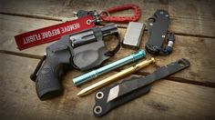 "EDC love the narrow knife and the ""vanguard"" looking holster for a revolver"