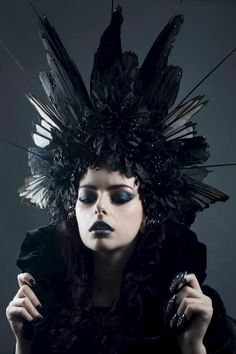 'Black Corvidae' Headdress - Creations by Liv Free    This amazing headdress is made from crow and magpie wings, black silk flowers, faux berries and glitter leaves. Black and silver crystals fall down onto the forehead of the wearer and hematite coloured crystals are dotted here and there around the feathers and flowers. Faux ornamental grass shards come out from around the feather wings to give this headdress an edgier feel. Be a true evil queen in this headdress.