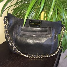 HP 12/24Marc Jacobs Leather Handbag HOST PICK 12/24 for the Holiday Style Party!  Beautiful Great Quality Marc Jacobs Black Leather Handbag with Dark Blue leather Detail.  Marc Jacobs Plate Adorns the Front with a Front Flap Pocket.  Exterior is in excellent condition.  Beautiful gold Chain Shoulder Strap with Leather woven through it.  The interior has some blue pen marks on the cloth lining.  No Trades & No PayPal Marc Jacobs Bags