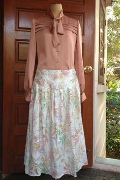 A personal favorite from my Etsy shop https://www.etsy.com/listing/278192700/pastel-jungle-in-vintage-skirt
