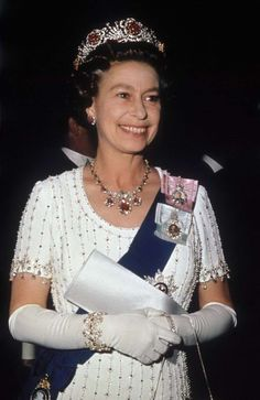 Baring Ruby Necklace worn with the Burmese Ruby Tiara and one of Queen Mary's chain link bracelets, the diamond evening watch and the Order of the Garter worn by HM Queen Elizabeth II