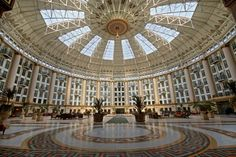 West Baden Springs Hotel, French Lick, IN. Originally a mineral springs resort in 1855, the current hotel was built in 1902 with this spectacular 200-foot-wide atrium. The stock market crash of '29 shrunk the clientele, and she closed in 1932, sold to the Jesuits for $1. The fathers had all lavish details removed for a seminary, but it was abandoned and rotting by 1983. In 1996, local preservationist magnates saved the crumbling hulk and carefully restored it to it's former glory.