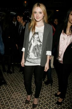 8209832a6b Dakota Fanning at the after party for The Runaways NY movie premiere.  Wearing a sweet graphic t-shirt with a jacket and heels!