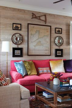 love the neutral and pink couch together.
