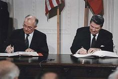 Picture of President Reagan and General Secretary Gorbachev signing the INF Treaty. - (Picture from the Ronald Reagan Library, courtesy of the National Archives)