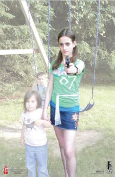 Law Enforcement Targets Inc. line of  'No More Hesitation.' Non-traditional threat depicting a hostile young mother surrounded by children on a playground.