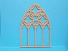 This beautiful carved dolls house church nave window, made to fit the All Saints dolls house church.