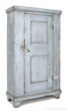 "ennsylvania painted pine cupboard, early 19th c., with a double sunken panel door, retaining a blue surface, 65"" h., 36"" w., 15"" d."