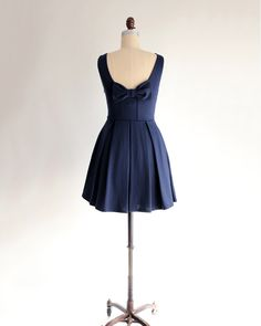 designed and made in los angeles ► a sleek fit & flare skater dress in navy blue stretch ponte knit► tried and true, customer favorite fabric for the ultimate flattering fit►full pleated skirt with hidden side pockets►reversible: may be worn with bow either in front or back► deep back scoop neckline with darling bow accent►a dress for all occasions : bridesmaids, weddings, events and parties   Shopping for another color? JANUARY is available also in Seafoam, Teal, Aqua, Charcoal, Cor...
