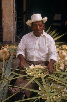 "Zapotec man making palm leaf decorations for a ""real"" Guelaguetza celebration in his neighborhood in Tlacolula Oaxaca"