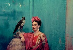 Frida Kahlo photographed by Nickolas Muray with her pet eagle, 1939 (via)