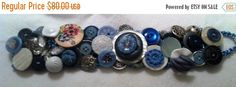 """This gorgeous button bracelet in blue measures 8"""" long and 13/4"""" wide.  It is adjustable with a button/loop closure.      The band is crocheted for a comfortable and easy fit.      The center piece on this bracelet is a 1 3/8"""" pressed Mother of Pearl button topped off with a beautiful Czechoslavakian glass button in blue.      You will find two more of these glass buttons on this bracelet along with early plastic, metal, a lovely 1 1/8"""" handpainted wooden button and several vegetable ivory…"""