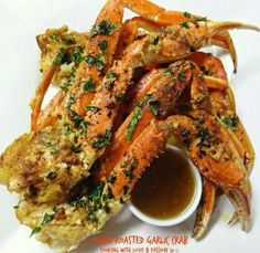 Simple dinner tonight-Oven Roasted Garlic Crab 2 lbs crab legs, defrosted 1/4 cup extra virgin olive oil 1-2 Tbsp  seafood seasoning-or favorite cajun seasoning 6-8 garlic cloves, chopped 1/4 cup f…