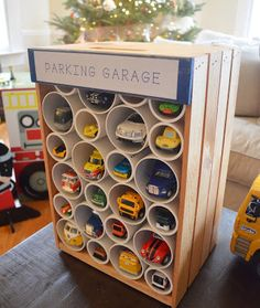 Parking garage idea from The Little White House Blog http://frugalfun4boys.com/2015/05/26/diy-wooden-crate-hot-wheels-car-storage-and-display/